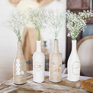 Flor mosquitinho artificial com garrafas decorativas